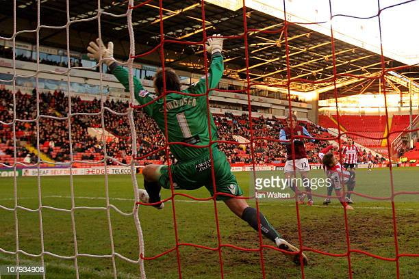 Marc Albrighton of Aston Villa scores the second goal during the FA Cup sponsored by EON 3rd Round match between Sheffield United and Aston Villa at...