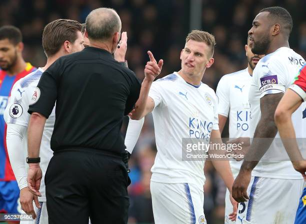 Marc Albrighton of Leicester argues with referee Mike Dean during the Premier League match between Crystal Palace and Leicester City at Selhurst Park...