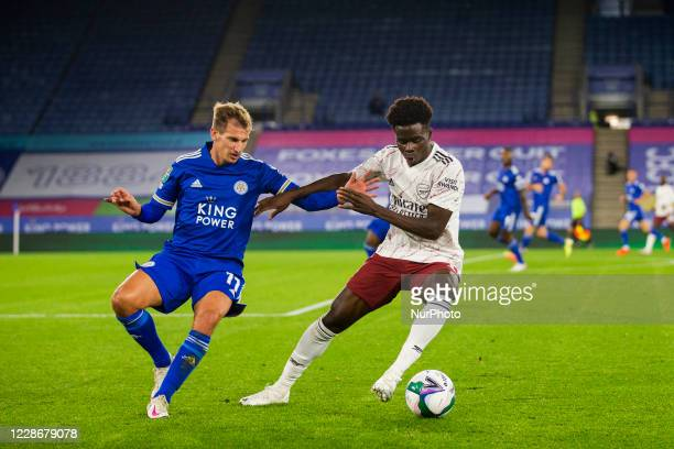 Marc Albrighton of Leicester City and Bukayo Saka of Arsenal during the Carabao Cup match between Leicester City and Arsenal at the King Power...