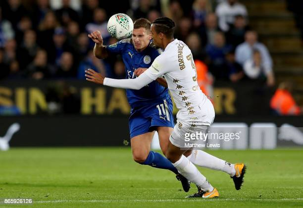 Marc Albrighton of Leicester City and Cameron BorthwickJackson of Leeds United in action during the Carabao Cup Fourth Round match between Leicester...