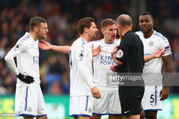 Marc Albrighton of Leicester City and teammates surround the referee after he is shown a red card during the Premier League match between Crystal...
