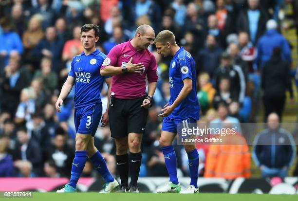 Marc Albrighton of Leicester City argues with referee Bobby Madley during the Premier League match between Manchester City and Leicester City at...