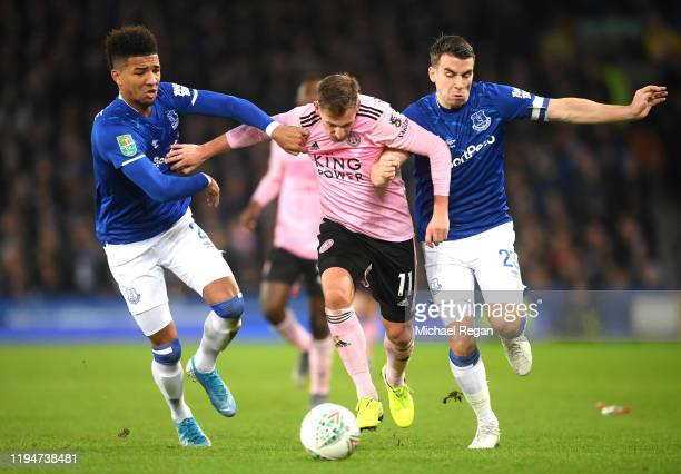 Marc Albrighton of Leicester City battles for possession with Seamus Coleman and Mason Holgate of Everton during the Carabao Cup Quarter Final match...