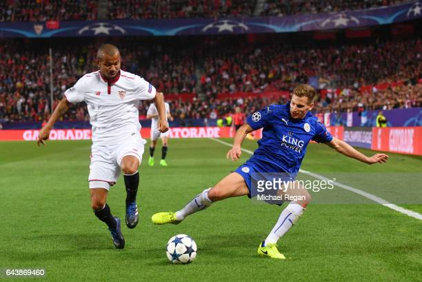 Marc Albrighton of Leicester City battles for the ball with Mariano of Sevilla during the UEFA Champions League Round of 16 first leg match between...