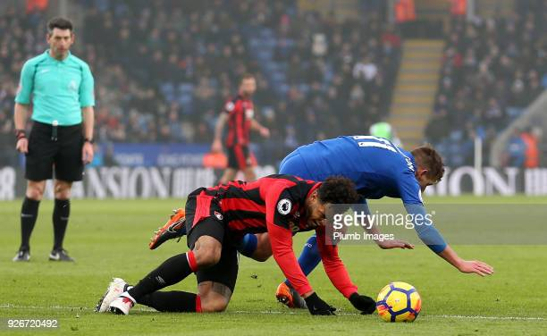 Marc Albrighton of Leicester City brings down Joshua King of Bournemouth in front of Referee Lee Probert leading to a penalty during the Premier...