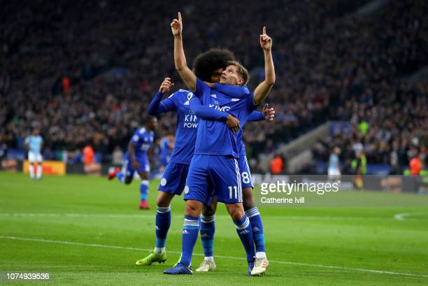 Marc Albrighton of Leicester City celebrates after scoring his team's first goal with his team mates during the Premier League match between...