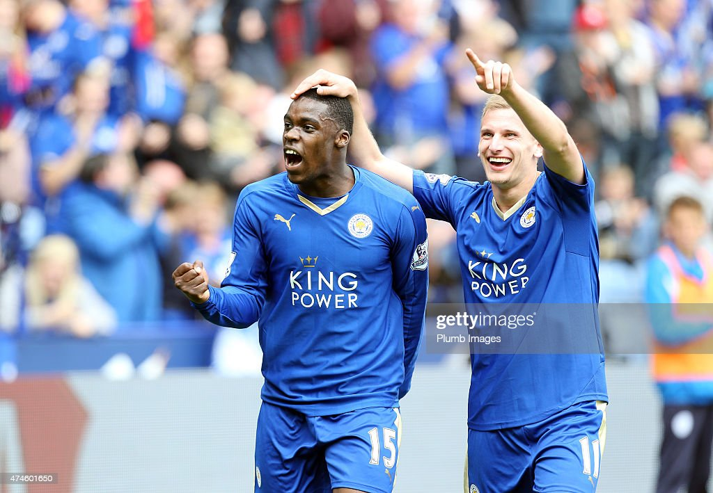 Marc Albrighton (R) of Leicester City celebrates after scoring to make it 2-0 during the Premier League match between Leicester City and Queens Park Rangers at The King Power Stadium on May 24, 2015 in Leicester, England.