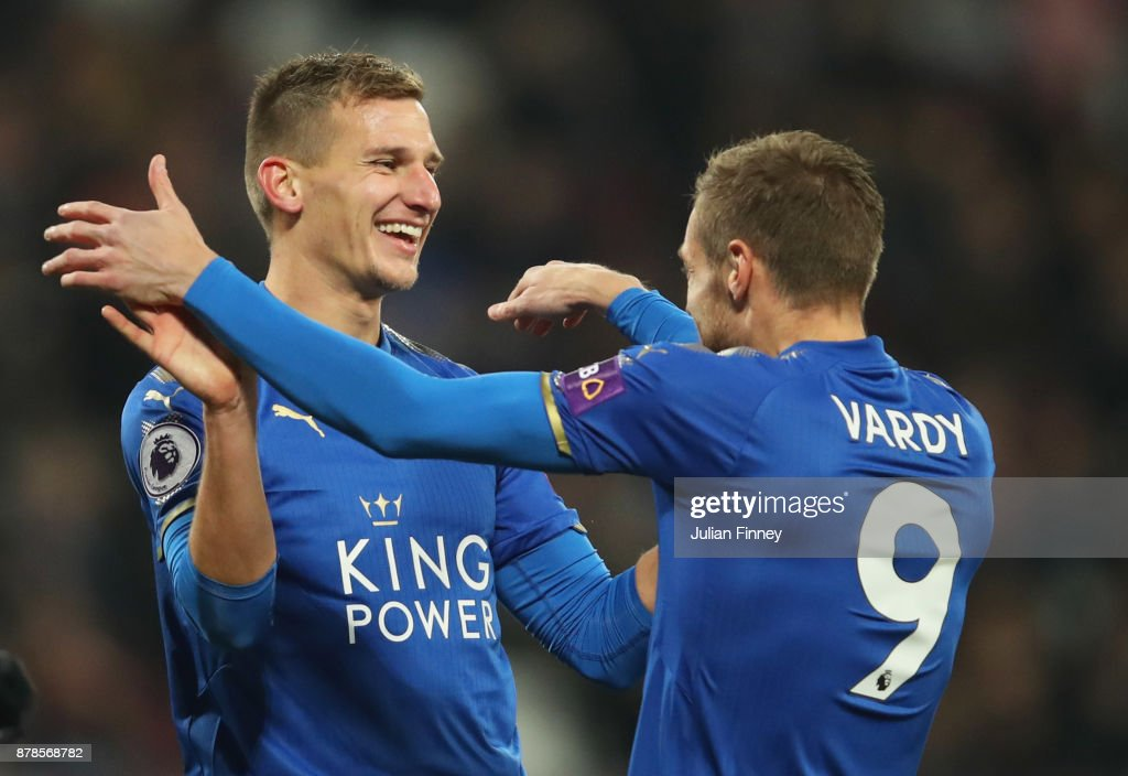 Marc Albrighton of Leicester City (L) celebrates as he scores their first goal with Jamie Vardy during the Premier League match between West Ham United and Leicester City at London Stadium on November 24, 2017 in London, England.