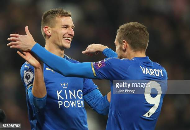 Marc Albrighton of Leicester City celebrates as he scores their first goal with Jamie Vardy during the Premier League match between West Ham United...