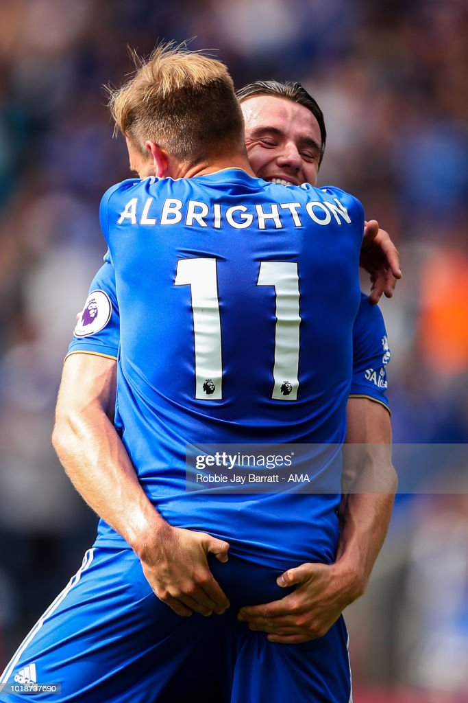 Marc Albrighton of Leicester City celebrates with Ben Chilwell of Leicester City after his cross results in an own goal from Matt Doherty of Wolverhampton Wanderers during the Premier League match between Leicester City and Wolverhampton Wanderers at The King Power Stadium on August 18, 2018 in Leicester, United Kingdom.