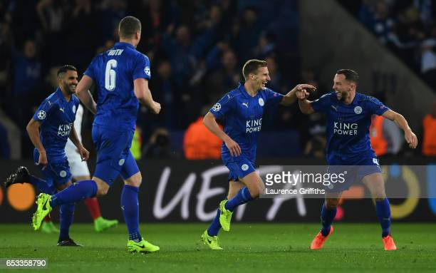 Marc Albrighton of Leicester City celebrates with teammate Danny Drinkwaterafter scoring his team's second goal during the UEFA Champions League...