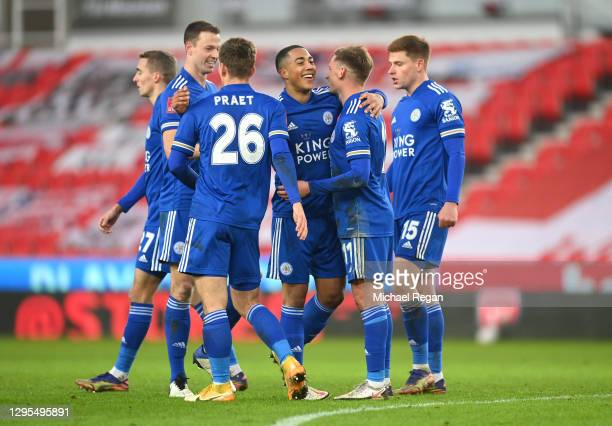 Marc Albrighton of Leicester City celebrates with teammates Jonny Evans, Dennis Praet, Youri Tielemans, and Harvey Barnes after scoring his team's...