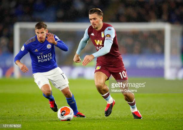 Marc Albrighton of Leicester City challenges Jack Grealish of Aston Villa during the Premier League match between Leicester City and Aston Villa at...