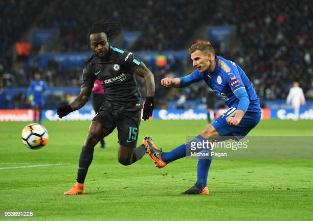 Marc Albrighton of Leicester City crosses past Victor Moses of Chelsea during The Emirates FA Cup Quarter Final match between Leicester City and...