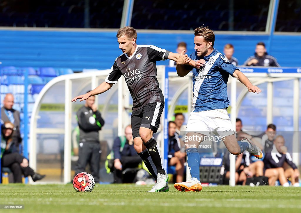 Marc Albrighton of Leicester City in action with Andrew Shinnie of Birmingham City during the pre-season friendly between Birmingham City and Leicester City at St Andrews (stadium) on August 1, 2015 in Birmingham, England.