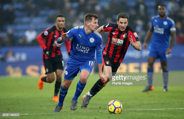 Marc Albrighton of Leicester City in action with Dan Gosling of Bournemouth during the Premier League match between Leicester City and Bournemouth at...