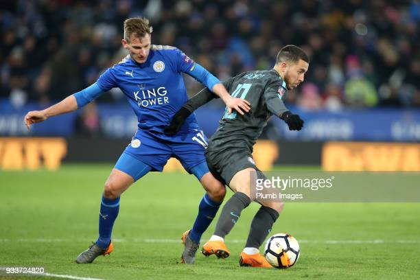 Marc Albrighton of Leicester City in action with Eden Hazard of Chelsea during The Emirates FA Cup Quarter Final tie between Leicester City and...