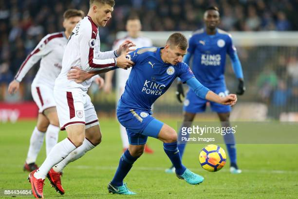 Marc Albrighton of Leicester City in action with Johann Berg Gudmundsson of Burnley during the Premier League match between Leicester City and...