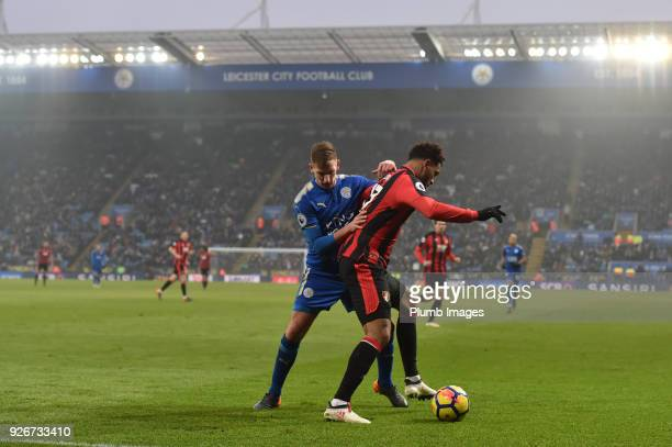 Marc Albrighton of Leicester City in action with Joshua King of Bournemouth during the Premier League match between Leicester City and Bournemouth at...