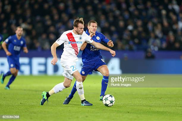 Marc Albrighton of Leicester City in action with Laurens De Bock of Club Brugge during the UEFA Champions League match between Leicester City and...