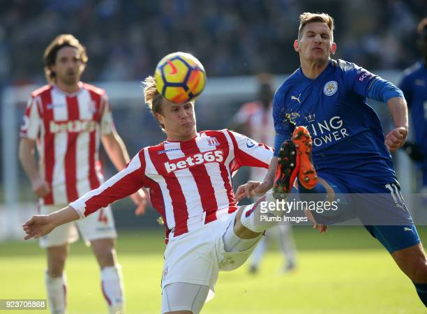 Marc Albrighton of Leicester City in action with Moritz Bauer of Stoke City during the Premier League match between Leicester City and Stoke City at...