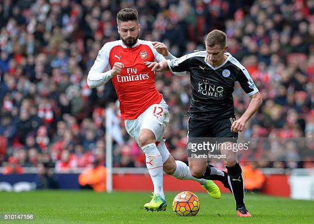 Marc Albrighton of Leicester City in action with Olivier Giroud of Arsenal during the Premier League match between Arsenal and Leicester City at...