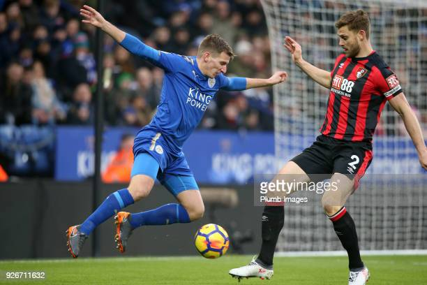 Marc Albrighton of Leicester City in action with Simon Francis of Bournemouth during the Premier League match between Leicester City and Bournemouth...