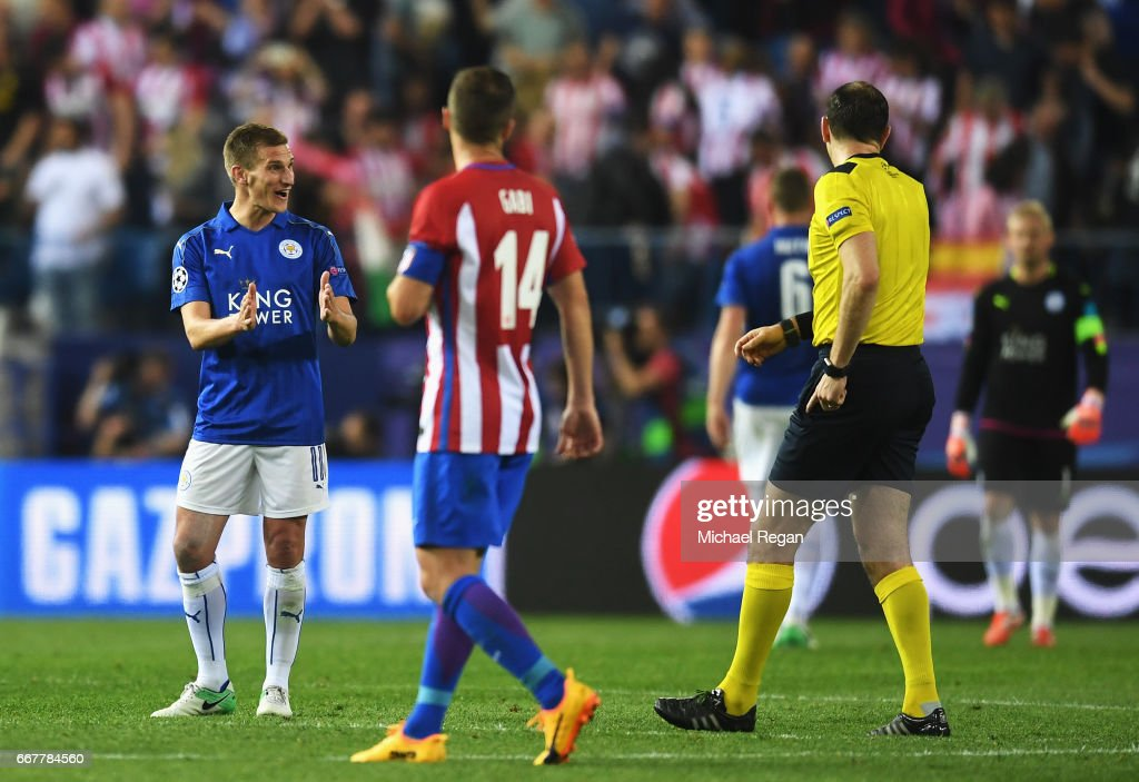 Marc Albrighton of Leicester City indicates to referee Jonas Eriksson, in his opinion, how far his challenge was outside the area leading to a penalty during the UEFA Champions League Quarter Final first leg match between Club Atletico de Madrid and Leicester City at Vicente Calderon Stadium on April 12, 2017 in Madrid, Spain.