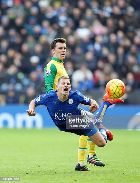 Marc Albrighton of Leicester City is brought down by Jonny Howson of Norwich City during the Barclays Premier League match between Leicester City and...