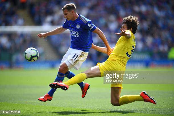 Marc Albrighton of Leicester City is challenged by Marcos Alonso of Chelsea during the Premier League match between Leicester City and Chelsea FC at...