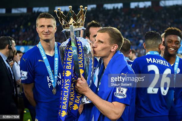 Marc Albrighton of Leicester City kisses the Premier League Trophy as players and staffs celebrate the season champions after the Barclays Premier...