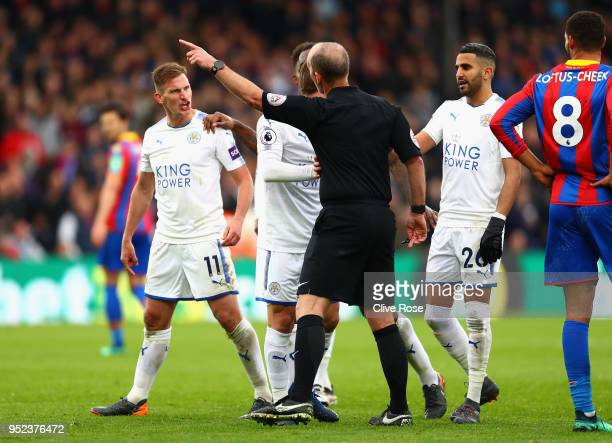 Marc Albrighton of Leicester City reacts after he is shown a red cardduring the Premier League match between Crystal Palace and Leicester City at...