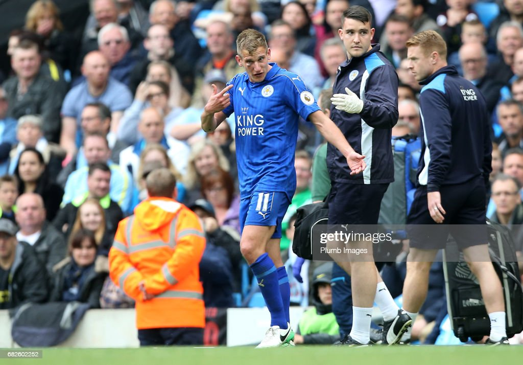 Marc Albrighton of Leicester City receives treatment after receiving a black eye during the Premier League match between Manchester City and Leicester City at Etihad Stadium on May 13 , 2017 in Manchester, United Kingdom.