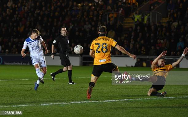 Marc Albrighton of Leicester City shoots over the crossbar while under pressure from Mickey Demetriou of Newport County during the FA Cup Third Round...