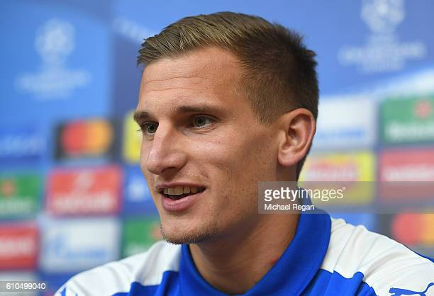 Marc Albrighton of Leicester City speaks during a Leicester City press conference ahead of their Champions League match against FC Porto at The King...