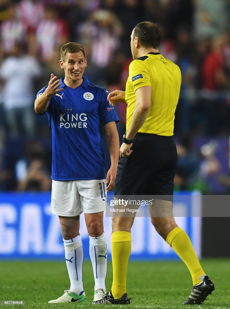 Marc Albrighton of Leicester City talks to referee Jonas Eriksson after the UEFA Champions League Quarter Final first leg match between Club Atletico de Madrid and Leicester City at Vicente Calderon Stadium on April 12, 2017 in Madrid, Spain.