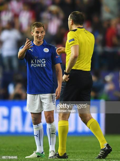 Marc Albrighton of Leicester City talks to referee Jonas Eriksson after the UEFA Champions League Quarter Final first leg match between Club Atletico...