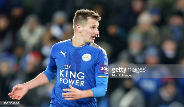 Marc Albrighton of Leicester City uses cotton buds to stem the blood from his nose during The Emirates FA Cup Quarter Final tie between Leicester...