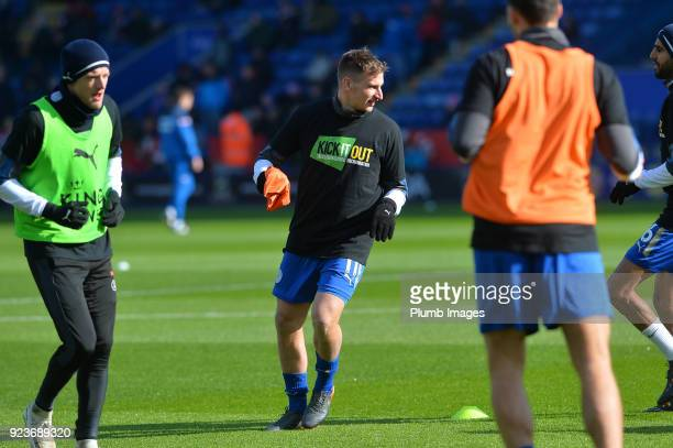 Marc Albrighton of Leicester City wears a Kick it out t shirt during the warm up at King Power Stadium ahead of the Premier League match between...