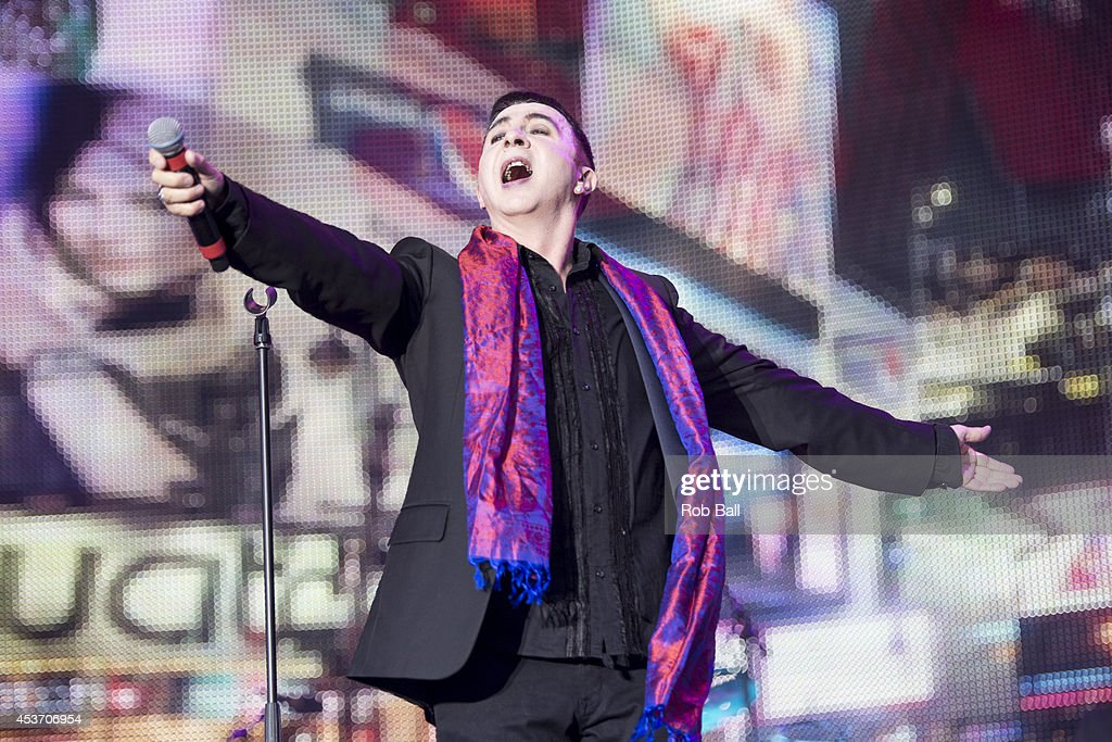 Marc Almond performs on stage at Rewind South 80s Music Festival at Temple Island Meadows on August 16, 2014 in Henley-on-Thames, United Kingdom.