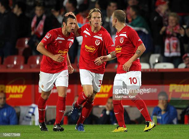 Marc Andre Kruska, Jules Reimerink and Daniel Adlung are seen during the Second Bundesliga match between FC Energie Cottbus and Karlsruher SC at...