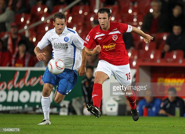 Marc Andre Kruska of Cottbus battles for the Ball with Anton Fink of Karlsruhe during the Second Bundesliga match between FC Energie Cottbus and...