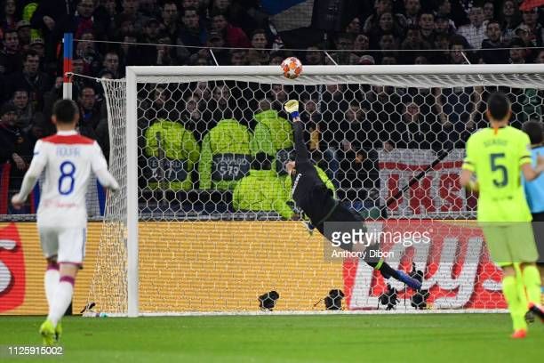 Marc Andre Ter Stegen of Barcelona stops the ball during the UEFA Champions League round 16 first leg match between Lyon and Barcelona at Groupama...