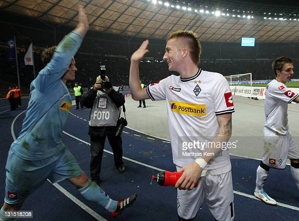 Marc Andre Ter Stegen of Moenchengladbach and his team mate Marco Reus show their delight after winning the Bundesliga match between Hertha BSC...