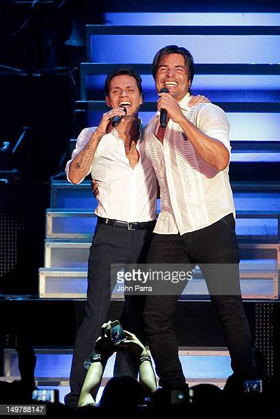 Marc Anthony and Chayanne perform during the tour opener at AmericanAirlines Arena on August 3 2012 in Miami Florida
