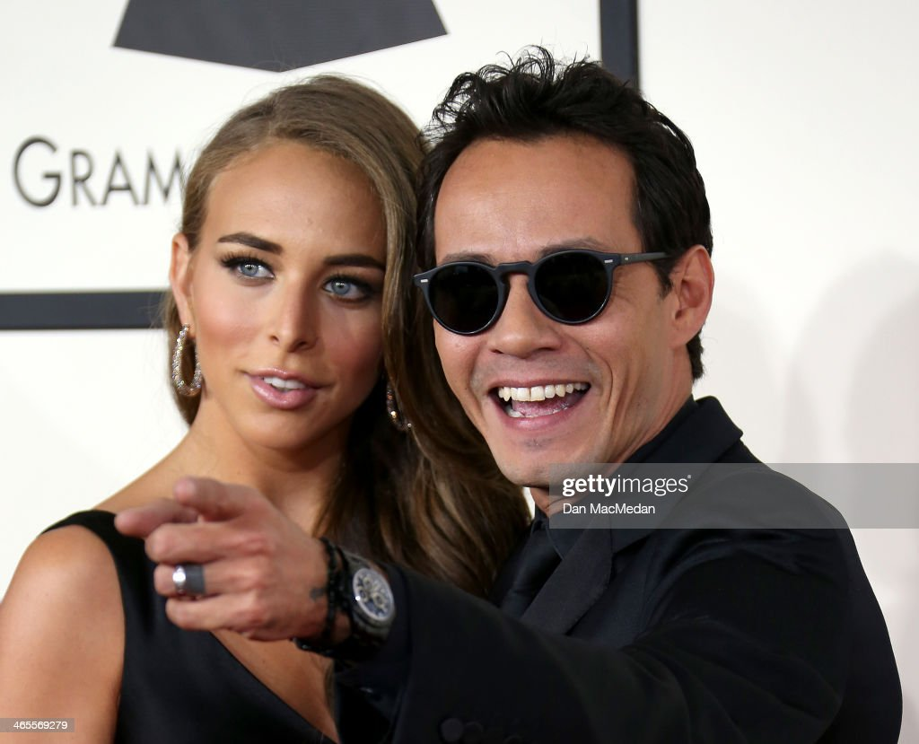 Marc Anthony (R) and Chloe Green arrive at the 56th Annual GRAMMY Awards at Staples Center on January 26, 2014 in Los Angeles, California.