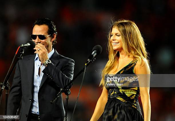 Marc Anthony and Fergie perform The National Anthem before the Miami Dolphins versus New York Jets game at Sun Life Stadium on September 26, 2010 in...
