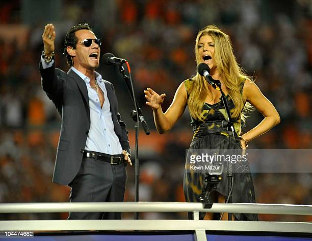 Marc Anthony and Fergie sing the national anthem at the Miami Dolphins vs New York Jets hispanic heritage home season opener at Sun Life Stadium on...