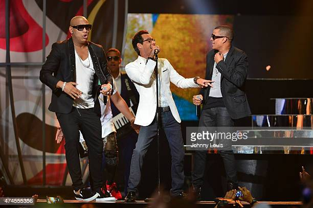 Marc Anthony and Gente de Zona performs at the 2015 Billboard Latin Music Awards presented by State Farm on Telemundo at Bank United Center on April...