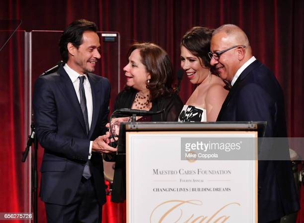 Marc Anthony and Henry Cardenas pose onstage with Rosal Colon and Rosalba Rolon at the Maestro Cares Foundation's fourth annual 'Changing...